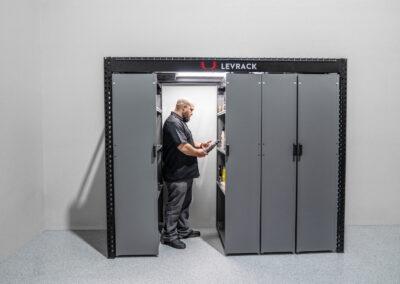 Worker using 8 foot Levrack storage unit